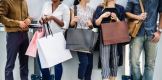 Diverse people holding shopping bags