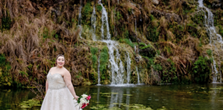 Bride posing in front of waterfall