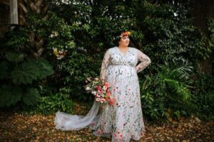 Plus size cruvy unique wedding gown with lace and floral crown