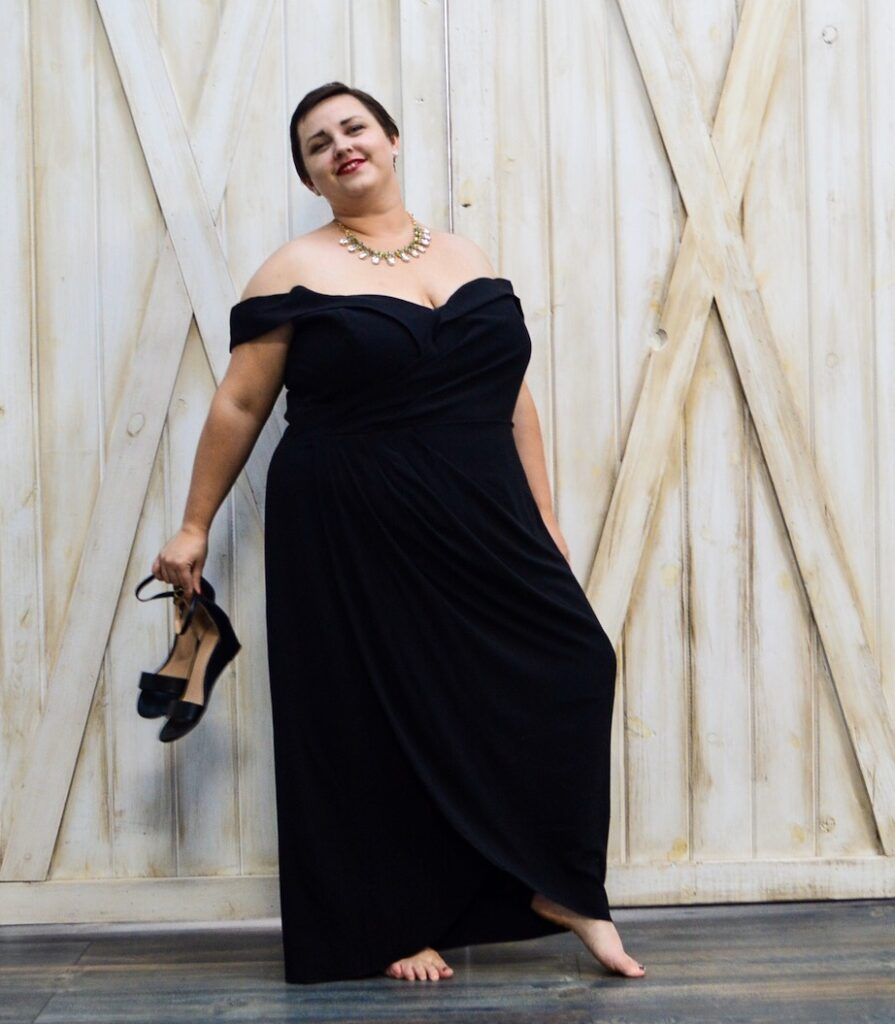 Plus size LGBT model in black holiday dress