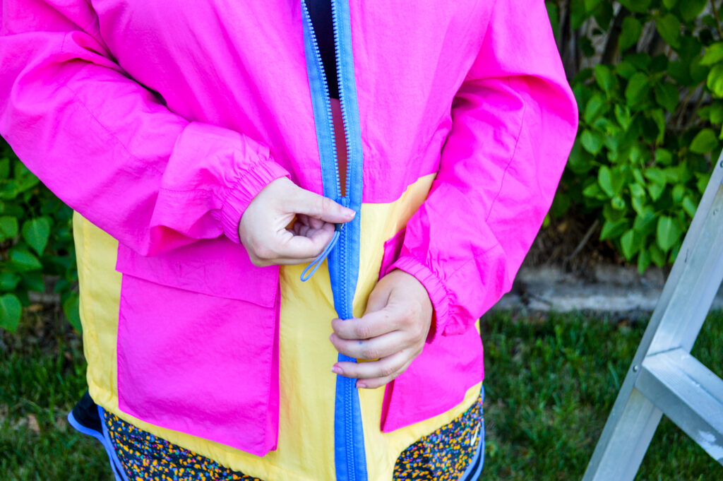 Bright pink and yellow Nike Sportswear Icon Clash Lightweight Woven Plus Size Jacket