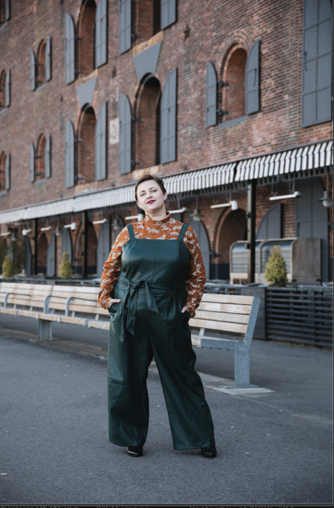 Plus size blogger with short hair modeling Anthropologie in NYC