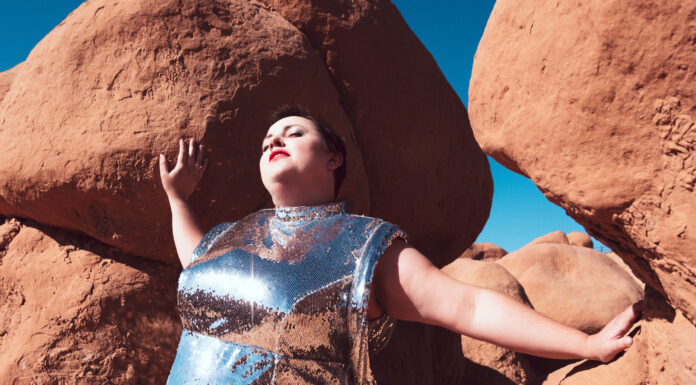Futuristic space explorer photoshoot in silver plus size model in salt lake city