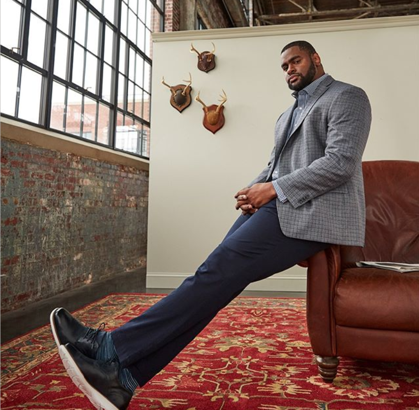 Big and tall fashion outfit with dark jeans and a sports coat for work
