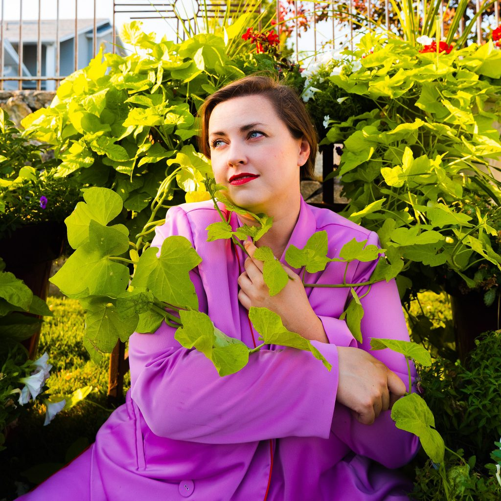 Blogger photoshoot at home plus size model in lavender suit from eloquii second hand fashion.jpg