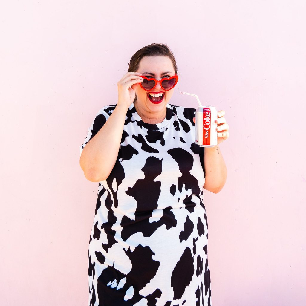 Fashion blogger from Utah in cow print dress trend