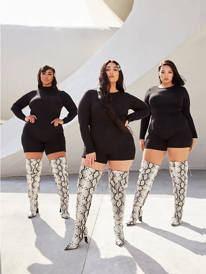 Thigh high faux snakeskin boots that are wide width
