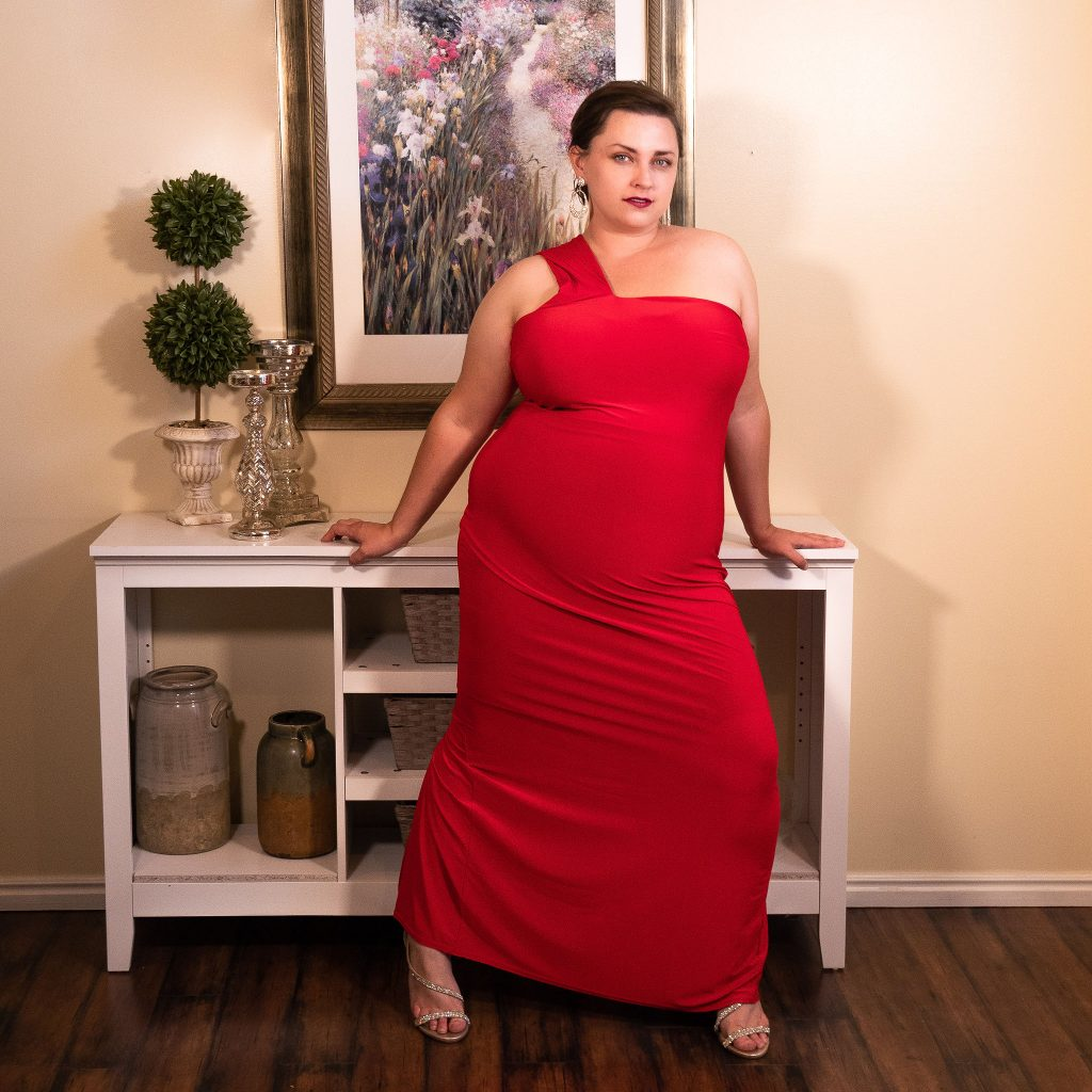 In-home fashion photoshoot with red dress and plus size model LGBT.jpg