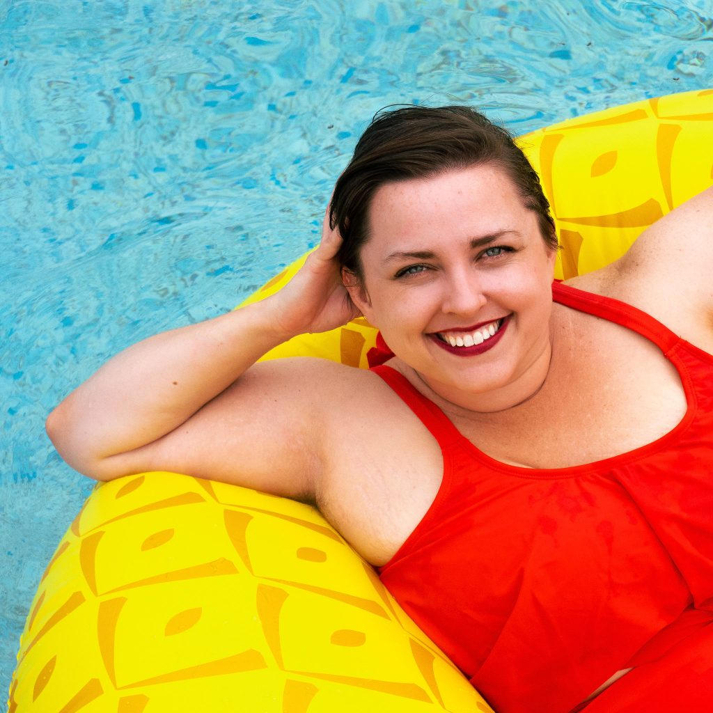 LGBT lifestyle blogger in swimsuit in pool during summer