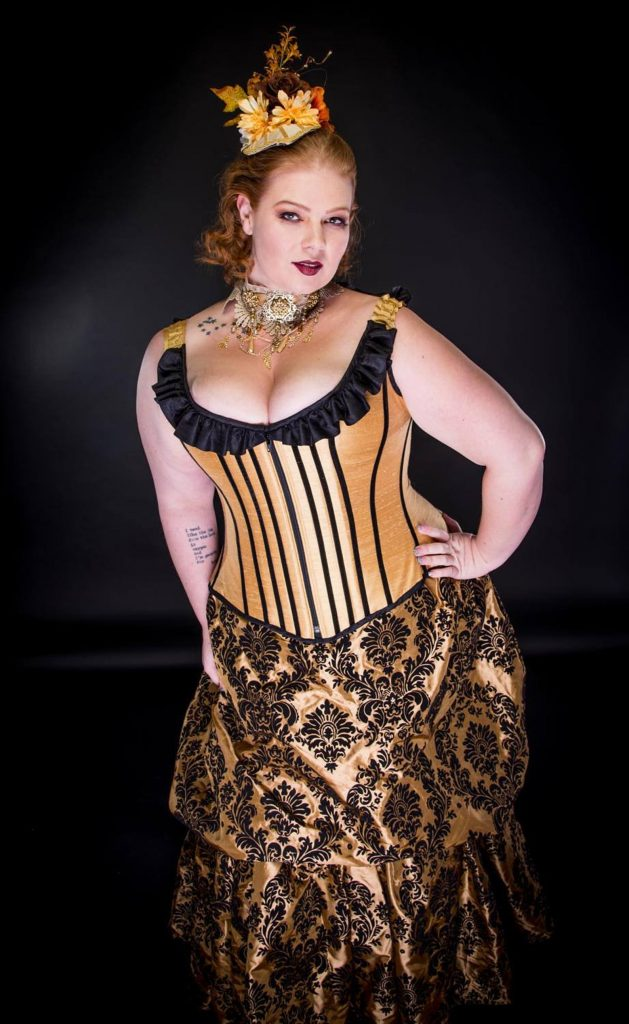 Plus size steampunk cosplay western saloon girl outfit with corset and bustle skirt.