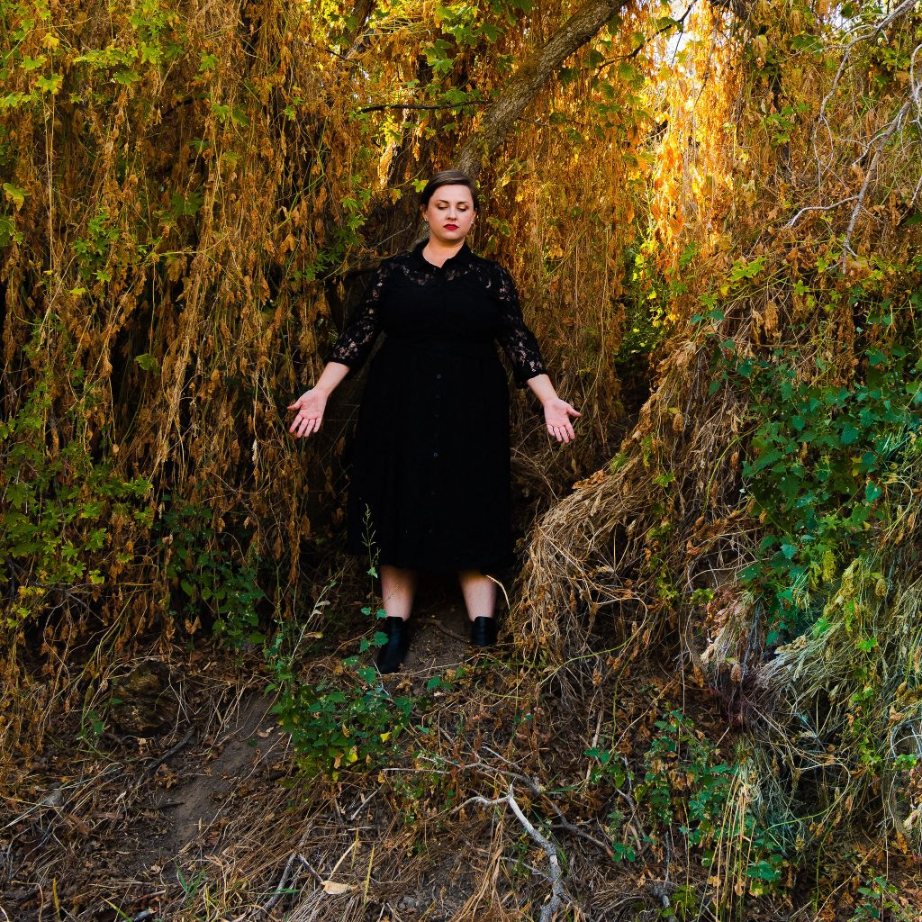 Plus size fall halloween witchy dress in forest with black boots inspired b Sabrina Netflix