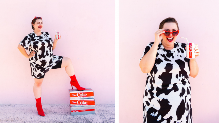 Cow print fashion trend fashion blogger with red boots and diet coke