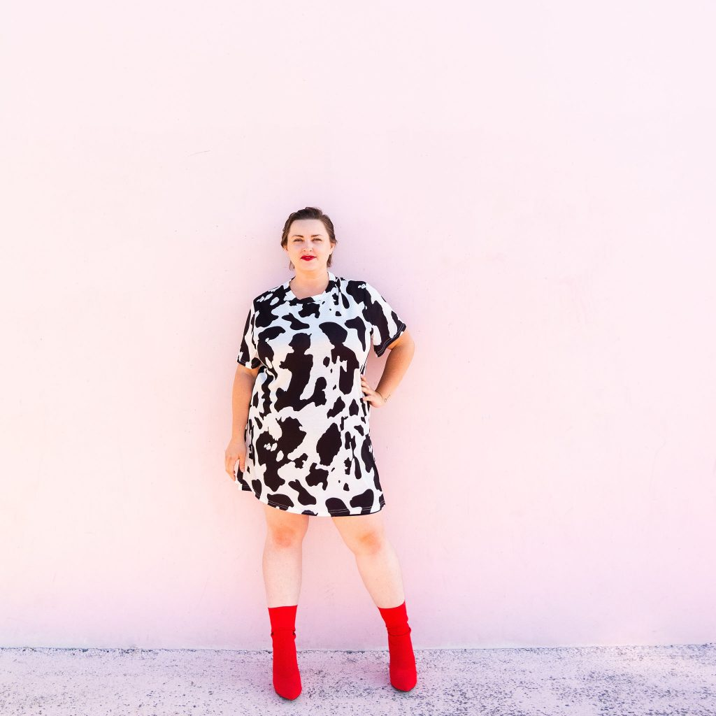Utah blogger in cow print dress and red boots