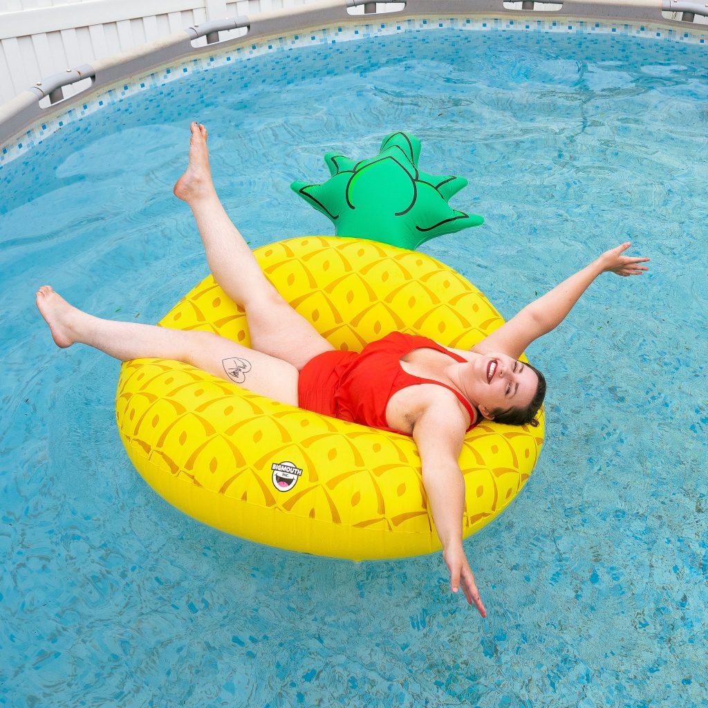 Utah lifestyle blogger in pool floatie in backyard during Summer.jpg