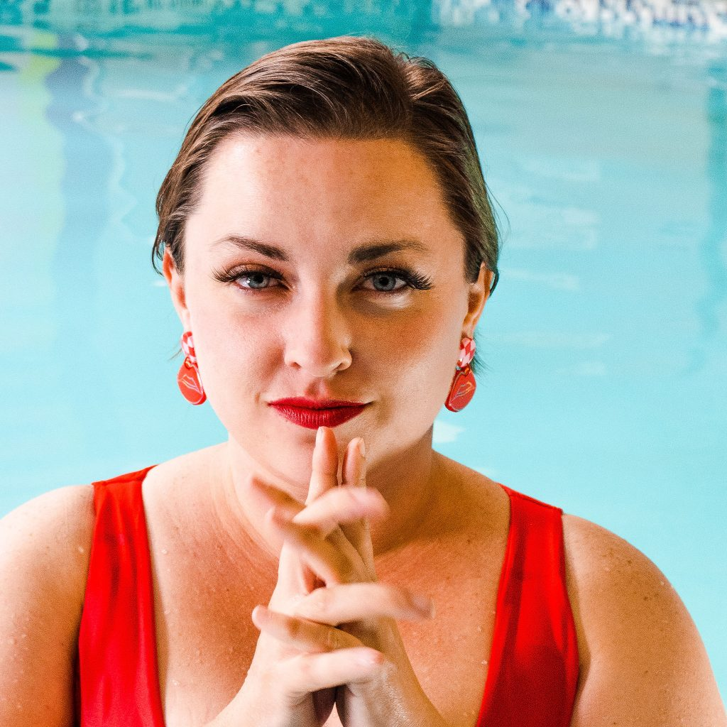 statement jewelry photoshoot on plus size model in swimming pool