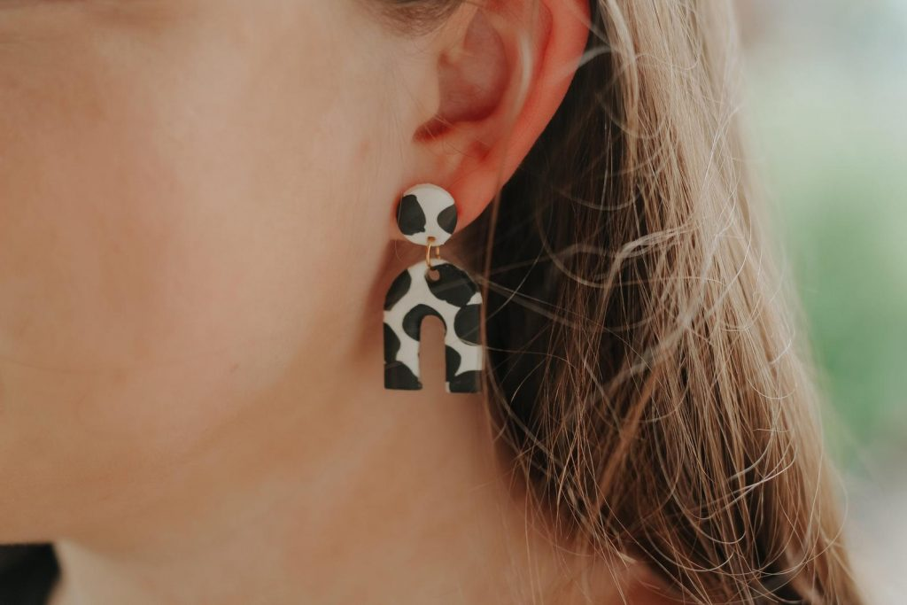 "cow print earrings, circle attached to upside down ""u"" polymer earrings"