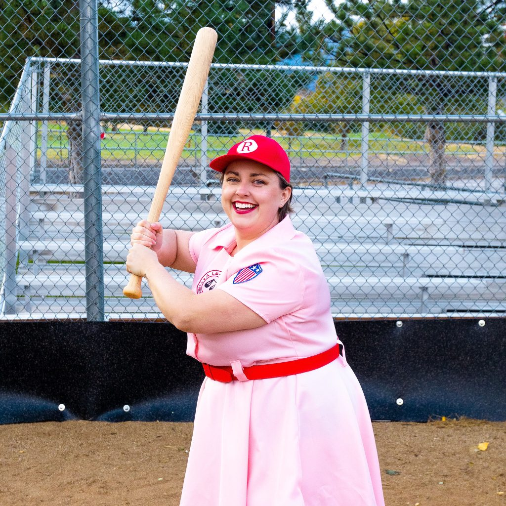 Costume Review - Plus Size a League of Their Own Halloween Costume - pink costume with blogger holding baseball bat