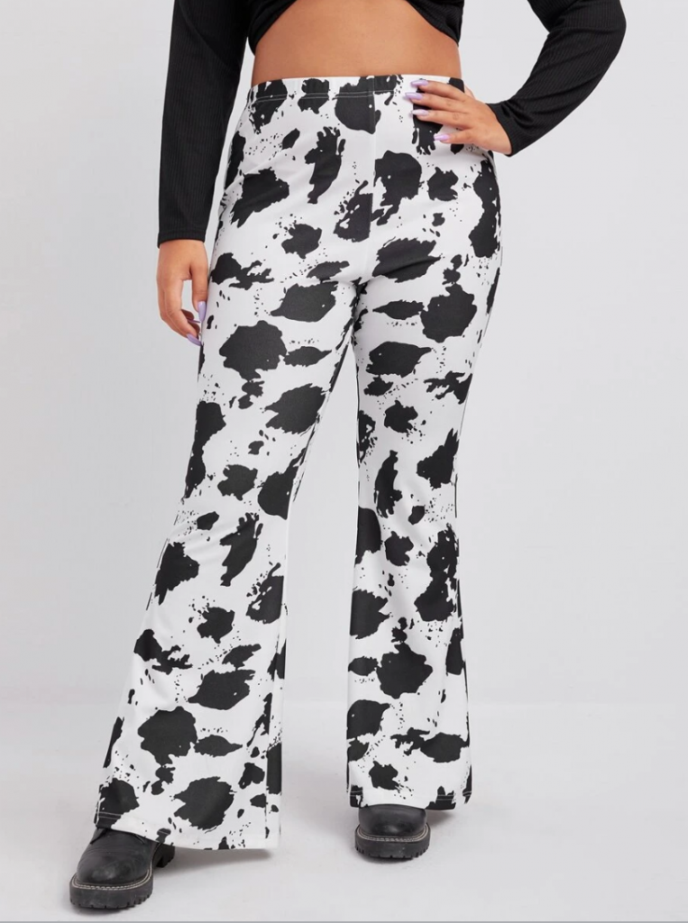 Shopping guide for cow print plus size clothing - model wearing plus size cow print pants