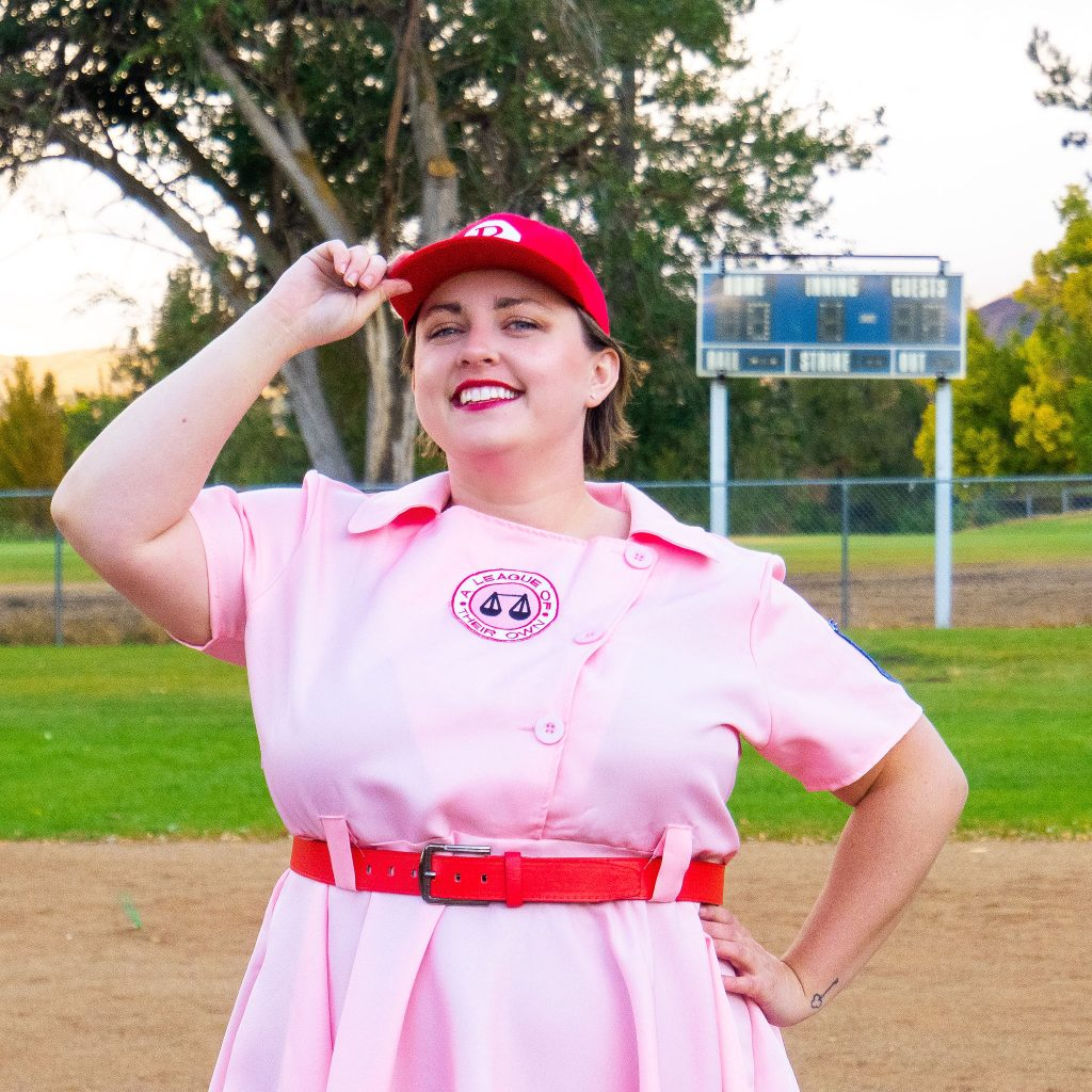 Costume Review - Plus Size a League of Their Own Halloween Costume - blogger posing with baseball cap
