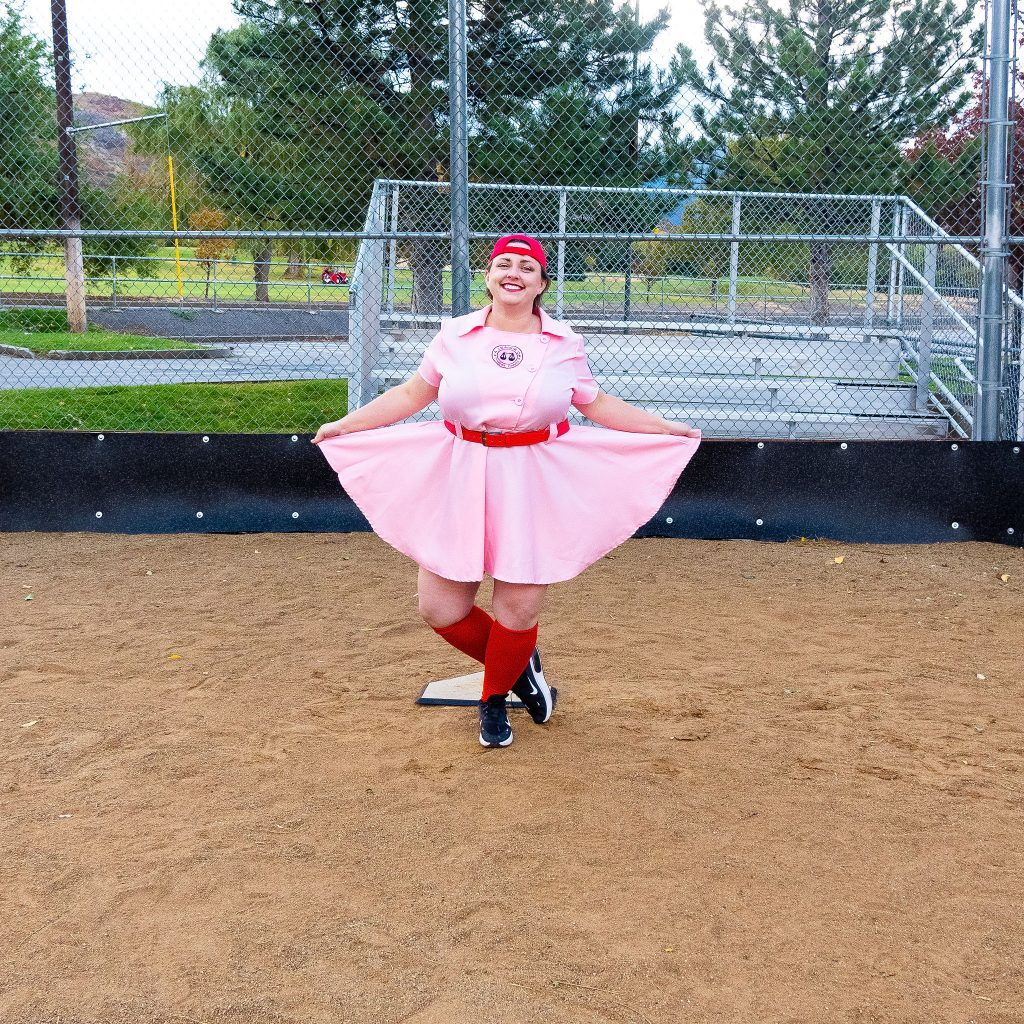 Costume Review - Plus Size a League of Their Own Halloween Costume - blogger posing in pink baseball dress