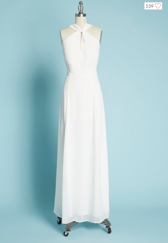 Simple white wedding dress with high kneck and wrap around detailing