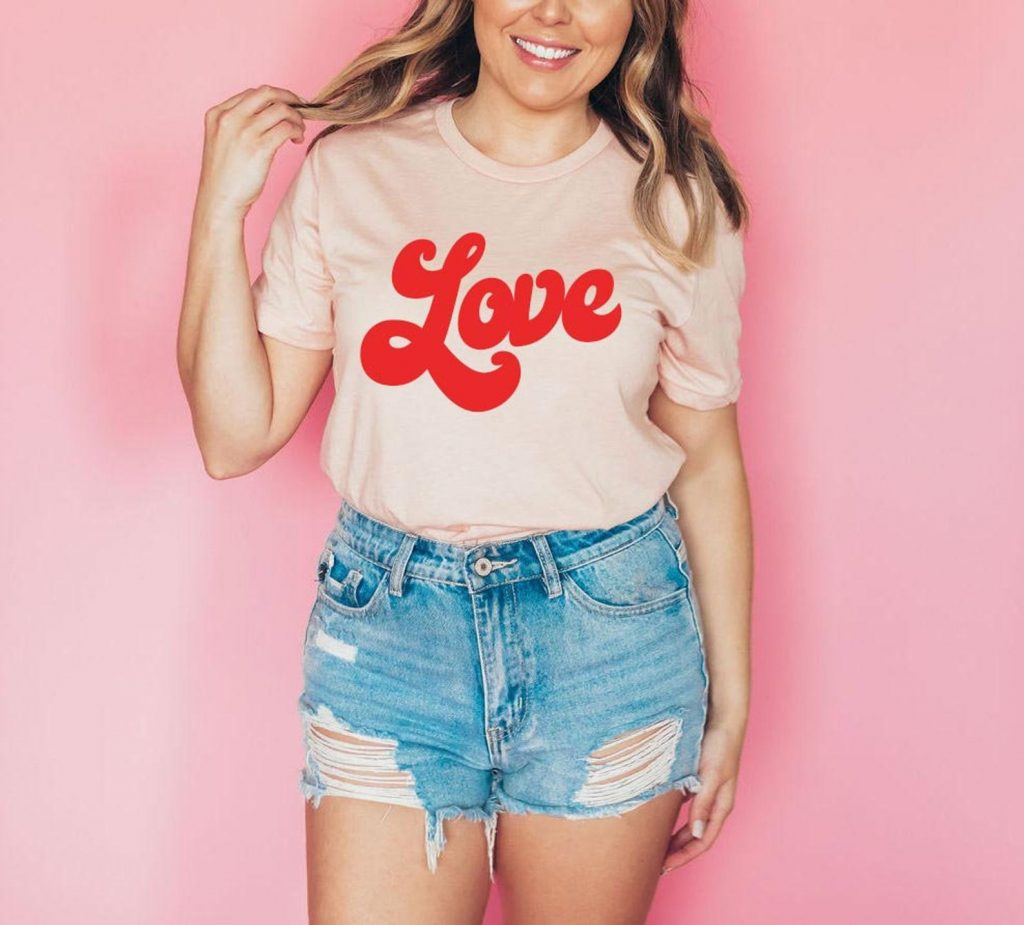 Retro vintage inspired pink Valentine's Day shirt with love font 1970's