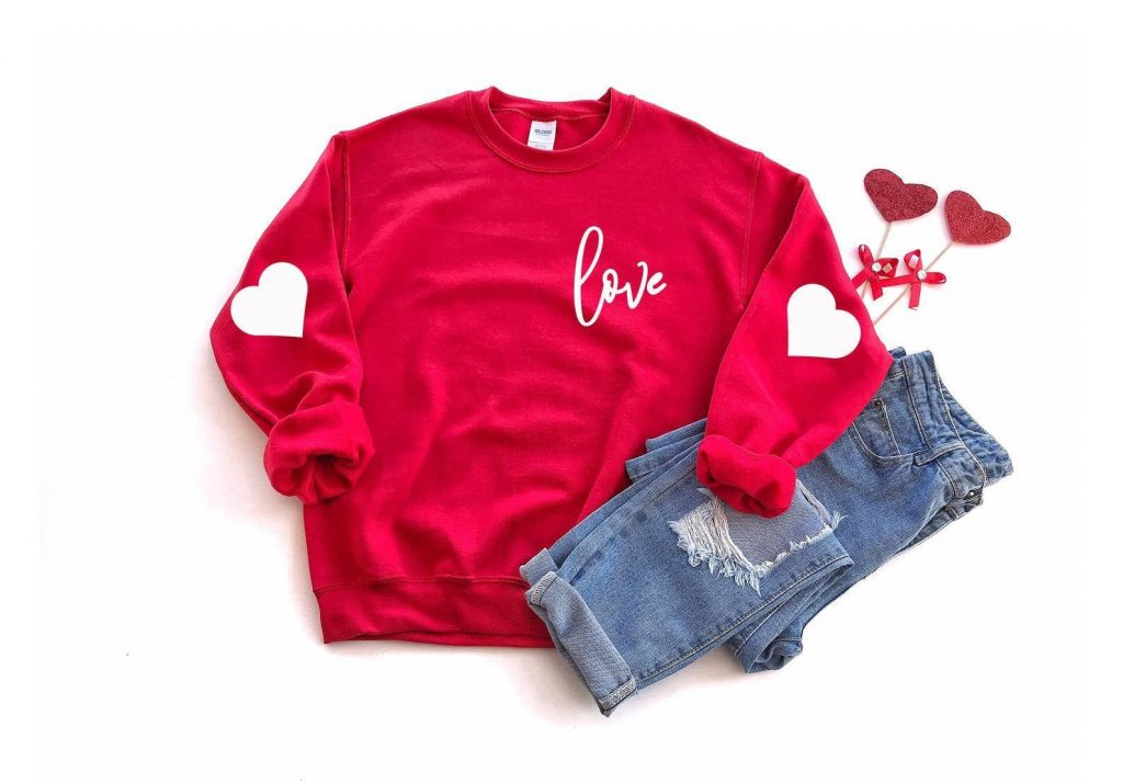 red Valentine's Day sweater with heart on elbows and love print